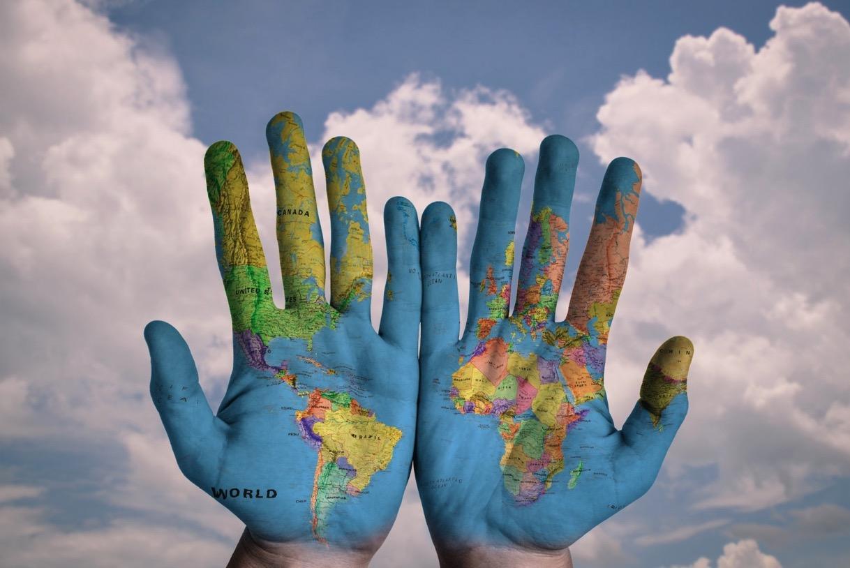 Hands world map global earth globe blue creative