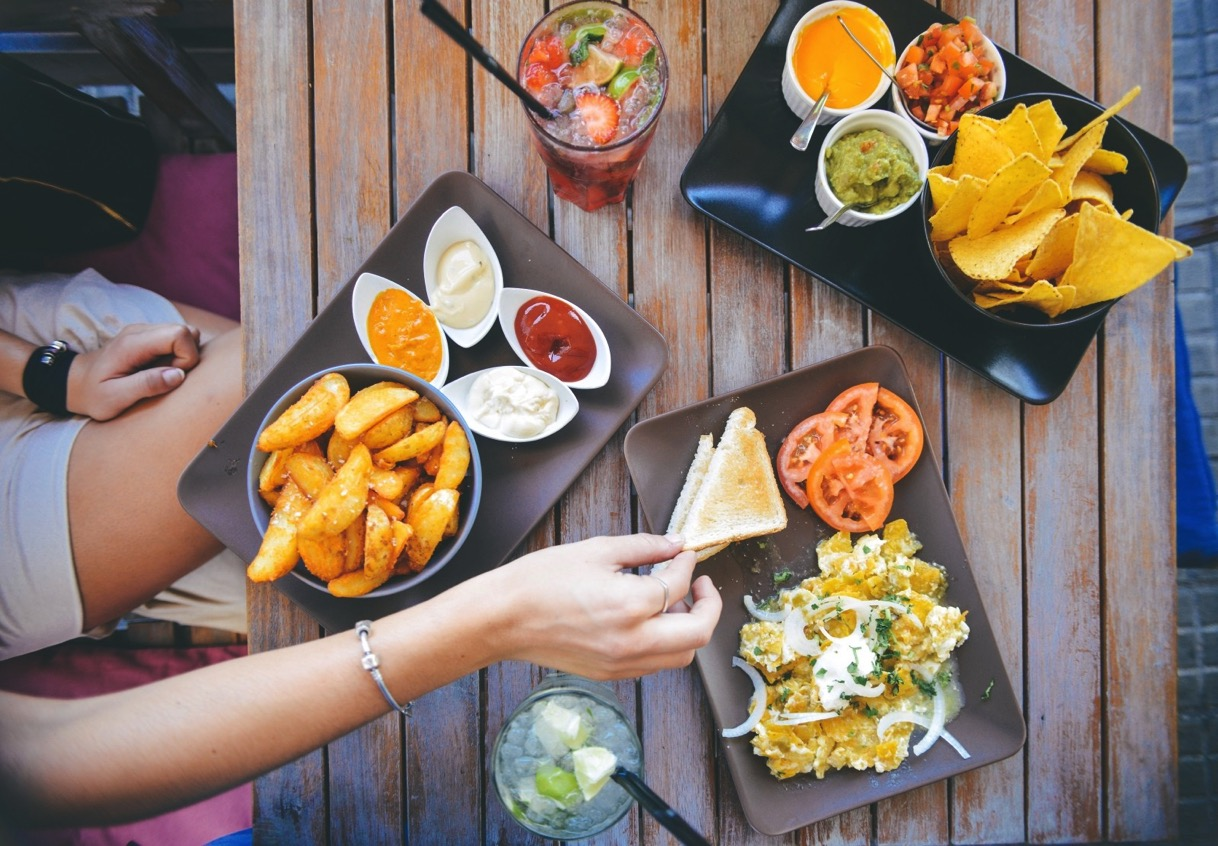 Woman eating mexican food in restaurant