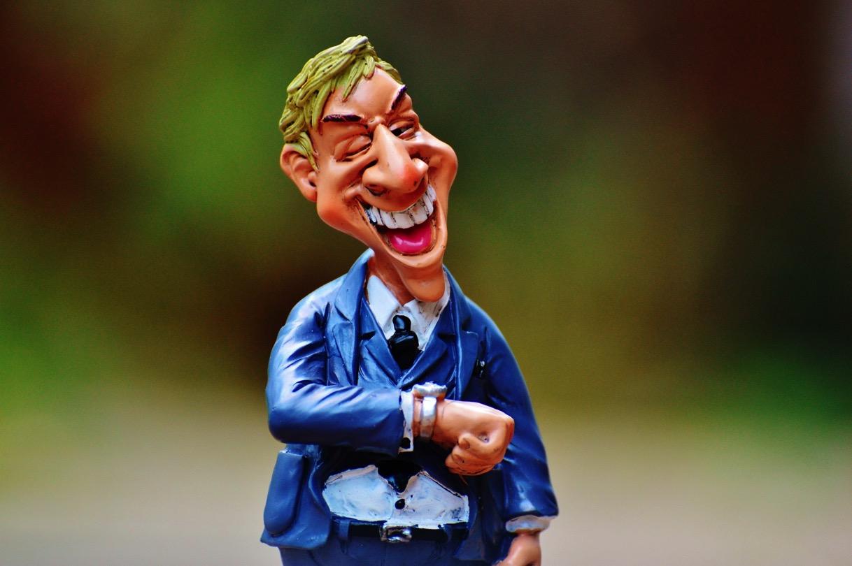 2 figurine of businessman