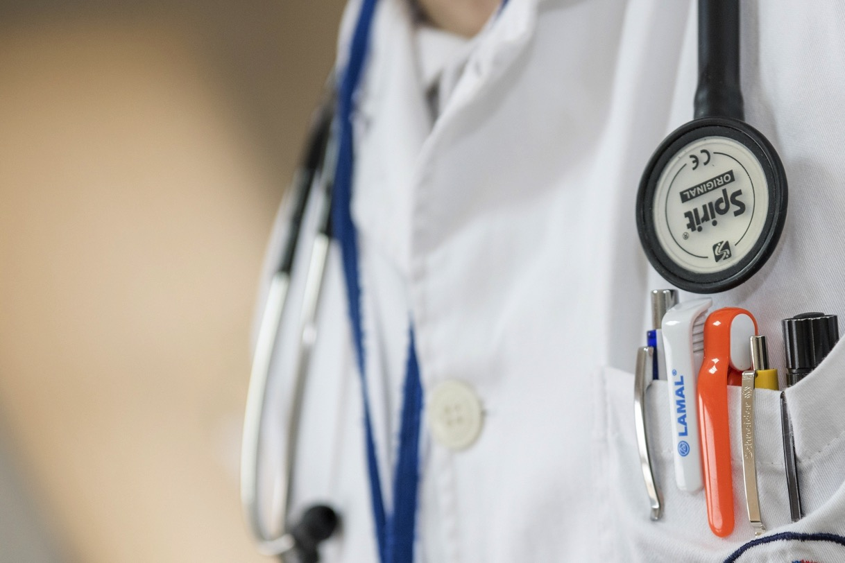 Close up of doctor with stethoscope and ballpens